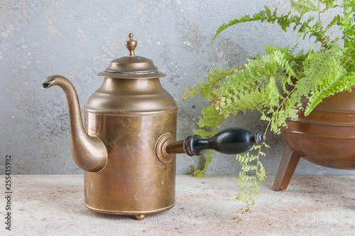 Fotografiet  Vintage brass kettle with wooden handle