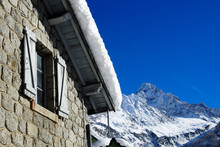 French Chalet Roof With Snow A...