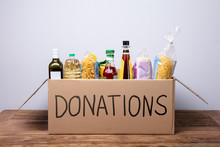 Various Foods In A Donation Cardboard Box