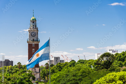 Torre Monumental (Torre de los Ingleses) clock tower in Retiro neighborhood, Buenos Aires, Argentina with the flag of Argentina