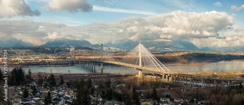 Cuadros en Lienzo Panoramic view of Port Mann going across Fraser River during a sunny winter day