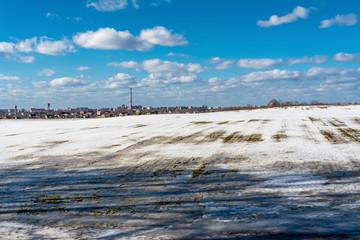 thawed patch on the field, snowy outdoor soccer field in spring low season