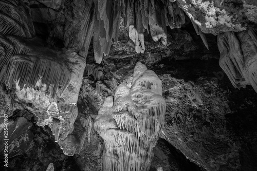 Abstract cave interior chamber photograph - bumpy rock surfaces and exotic rock formations. Textures, rugged surface, underground exploration. Alien planet concept, cave geology.