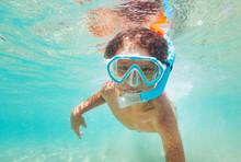 Happy Kid Boy Snorkeling In Clear Blue Sea