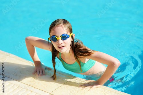 Cute Young Girl Wearing Swimming Goggles Having Fun In Outdoor