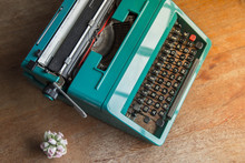 Vintage Typewriter Sitting On Wooden Table Good For A Writer, Author Or Editor Who Needs A Creative Concept
