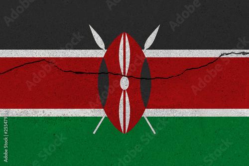 Fotografie, Obraz  Kenya flag on concrete wall with crack