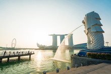 Sunrise In Marina Bay With Merlion Central District