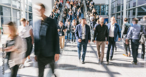 blurred business people crowd at a trade fair - 255497501