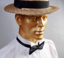 Male Mannequin Wearing A Boater Hat, In A White Shirt With A Black Bow Tie