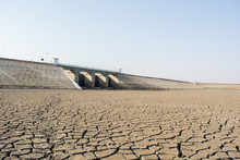 A Dried Up Empty Reservoir Or Dam During A Summer Heatwave, Low Rainfall And Drought In North Karnataka,India