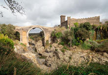 Vulci (Italy) - The Medieval Castle Of Vulci, Now Museum, With Devil's Bridge. Vulci Is An Etruscan Ruins City In Lazio Region, On The Fiora River Between Montalto Di Castro And Canino.