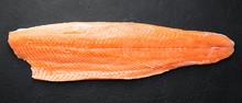 Fresh Raw Salmon Fish Steak On Dark Stone Background.