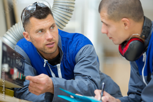 young handsome technician and his teacher