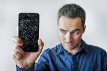 Sad Man Holds Broken Smartphone. Screen Broken Iphone.