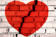 Red Broken Heart On The Brick Wall With Big Crack In The Middle. Concept Of Broken Love