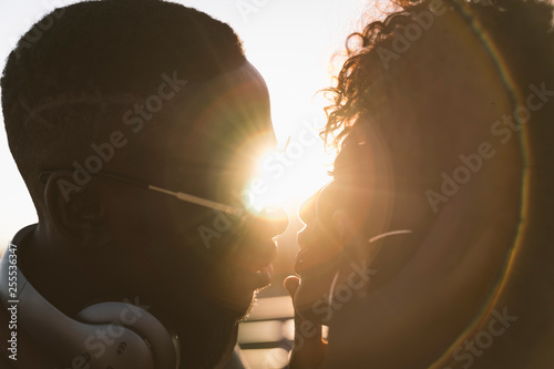 Fotografia, Obraz  Close-up couple of African boy and girl kissing.