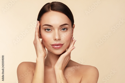 Fototapety, obrazy: Skin care,Beauty treatment and spa concept. Attractive model with brown hair and  Clean Fresh Skin touch own face