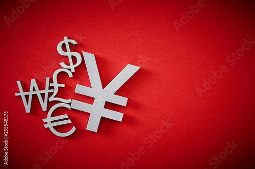 Photo  Currency symbols on red background