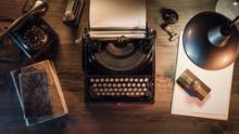 Vintage Journalist Desktop With Typewriter And Telephone