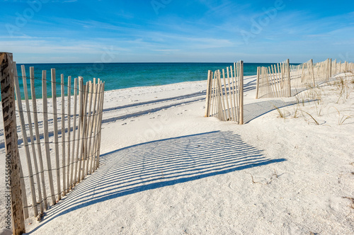 Empty white sand beach with fences,  Gulf of Mexico coast, Alabama, USA Canvas Print