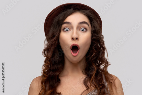 Fototapeta Photo of emotive young one woman, dressed in casual outfit, reacts on something