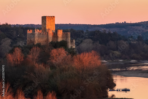 Valokuva  Almourol, Portugal - January 12, 2019: Almourol castle standing high above the water of the Tagus river