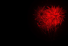 Beautiful Festive Red Fireworks On Black Background