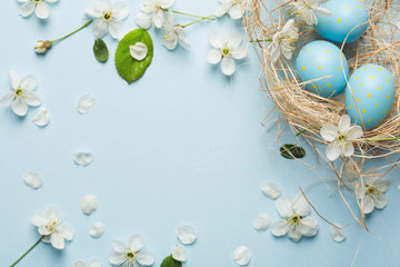 painted blue Easter eggs in...
