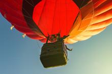 Red Hot Air Balloon Against Th...