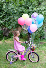 Little Girl Is Riding On Pink ...