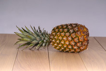 The Composition Of The Whole Pineapple On A Light Background