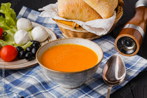 Fotografie, Obraz  traditional pumpkin soup, homemade with bread