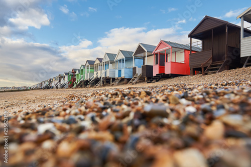Photo  Colorful cottages on the beach in Southend