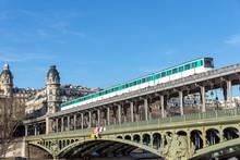 Metro Traffic On Pont Bir-Hakeim (Passy Viaduc) With View Over Passy Station Buildings - Paris, France