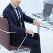 close up. Executive businessman sitting at the Desk