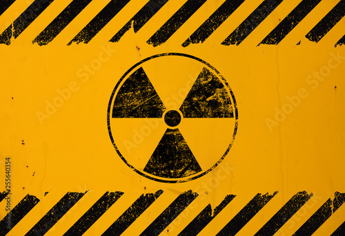 Fotografie, Obraz Black radioactive sign over yellow background