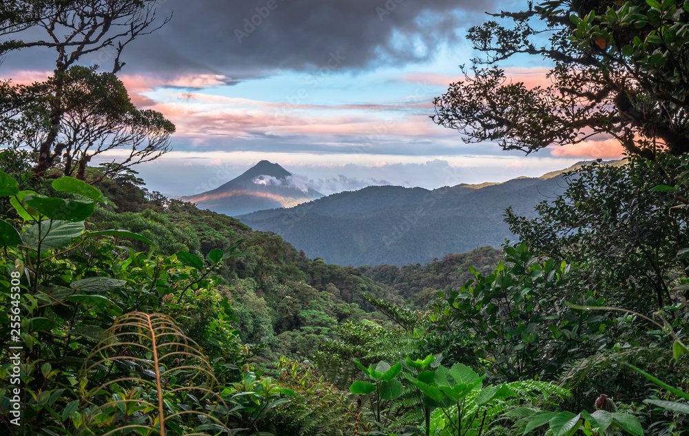 Fototapeta Volcan Arenal dominates the landscape during sunset, as seen from the Monteverde area, Costa Rica.