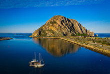 Morro Bay Rock At The Central California Coast With Reflection In The Water