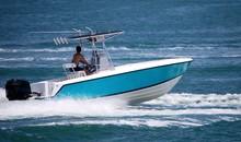 Open Sport Fishing Boat Light Blue With White Trim Speeding On The Florida Intra-Coastal Waterway Off  Miami Beach.