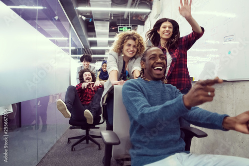 multiethnics business team racing on office chairs Poster Mural XXL