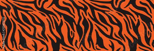 Fotografia Texture of bengal tiger fur, orange stripes pattern