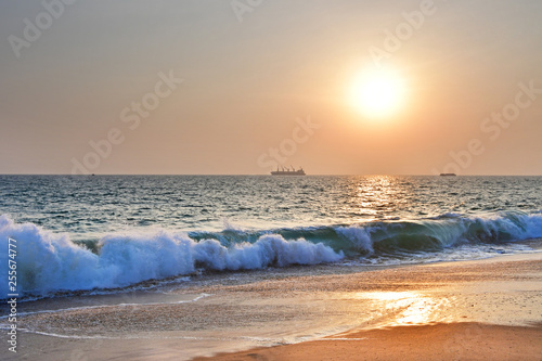 India, Kerala. Beach of the Indian ocean at sunset Wallpaper Mural