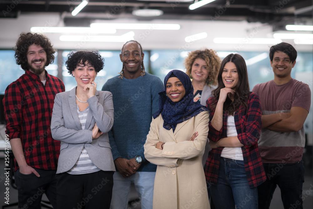 Fototapeta portrait of young excited multiethnics business team