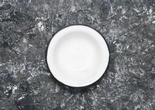 White Enamel Bowl On Concrete Background. Top View