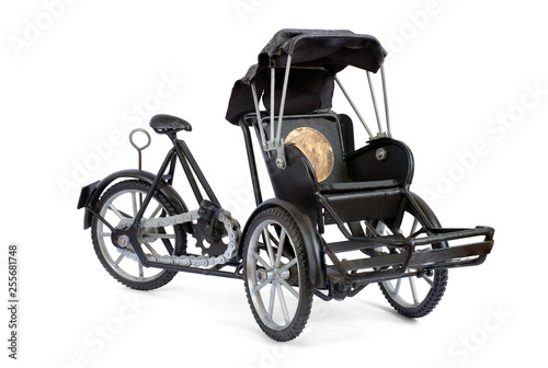 Fotografie, Obraz  Wheeler tricycle taxi, Tricycles small-sized, Vintage model isolated on a white background