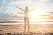 Girl traveller in a morning sun dawn on a tropical beach resert. Beautiful woman enjoys her summer vacation, sea. sun and beach