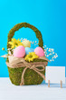 Colorful easter eggs in backet on a blue background