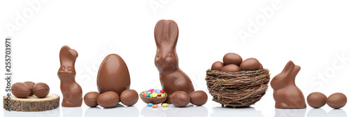 Foto Chocolate Easter bunny, eggs and sweets on white background