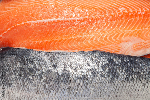 Leinwand Poster Closeup fresh norwegian salmon fillet fish on professional restaurant kitchen